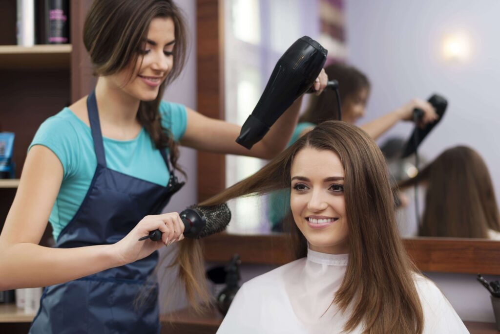 female hairdresser using hairbrush hair dryer min 1 1024x683 - 7 high-paying jobs in the beauty industry and how to find them